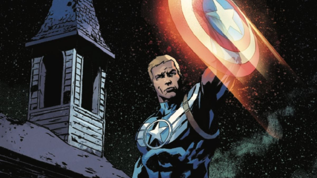 Steve Rogers (Captain America) raises his shield to protect a young migrant boy in Captain America #13, Marvel Comics (2019).