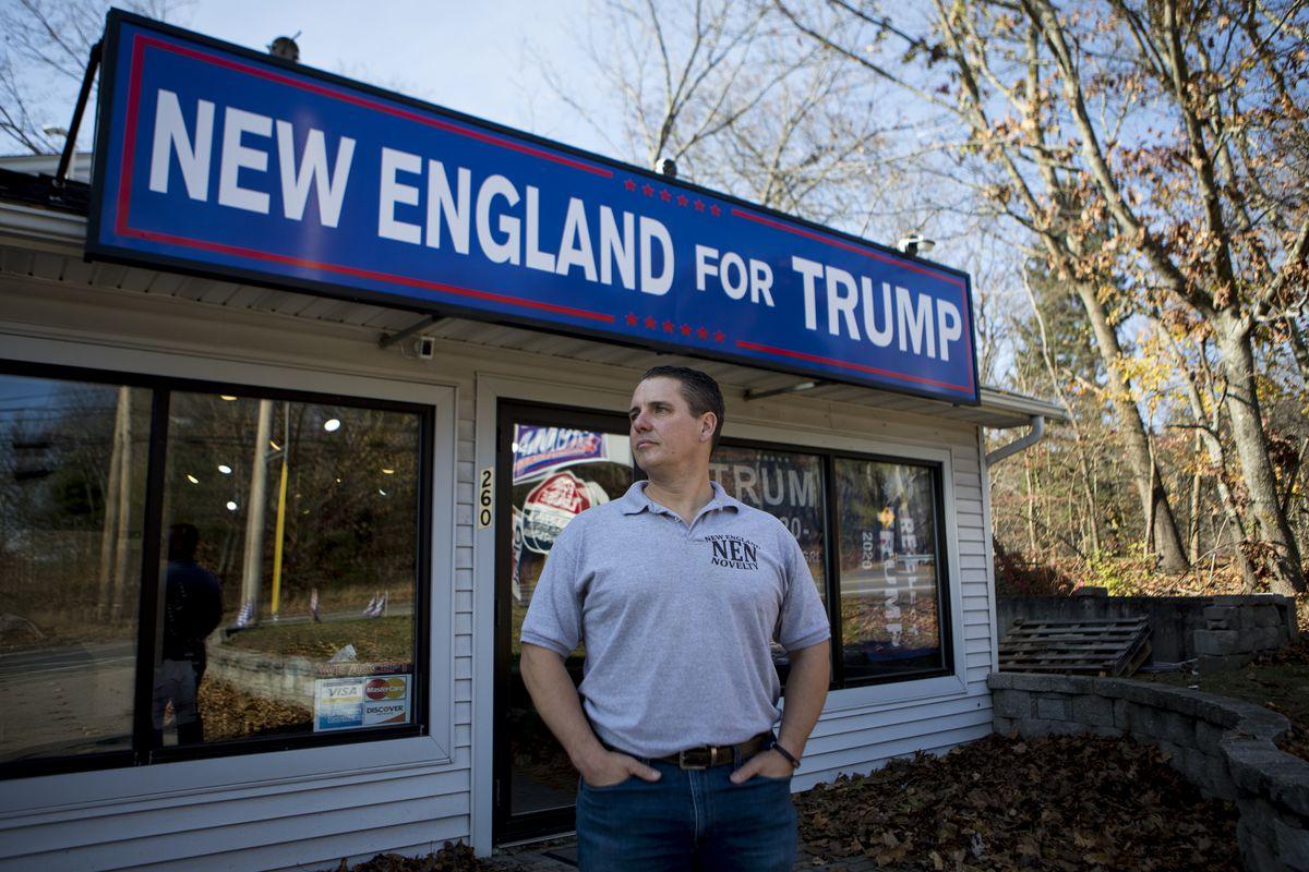 Rhode Island entrepreneur Keith Lambert poses for a portrait outside his store that sells Donald Trump merchandise in Bellingham, Mass., Saturday, Nov. 9, 2019.