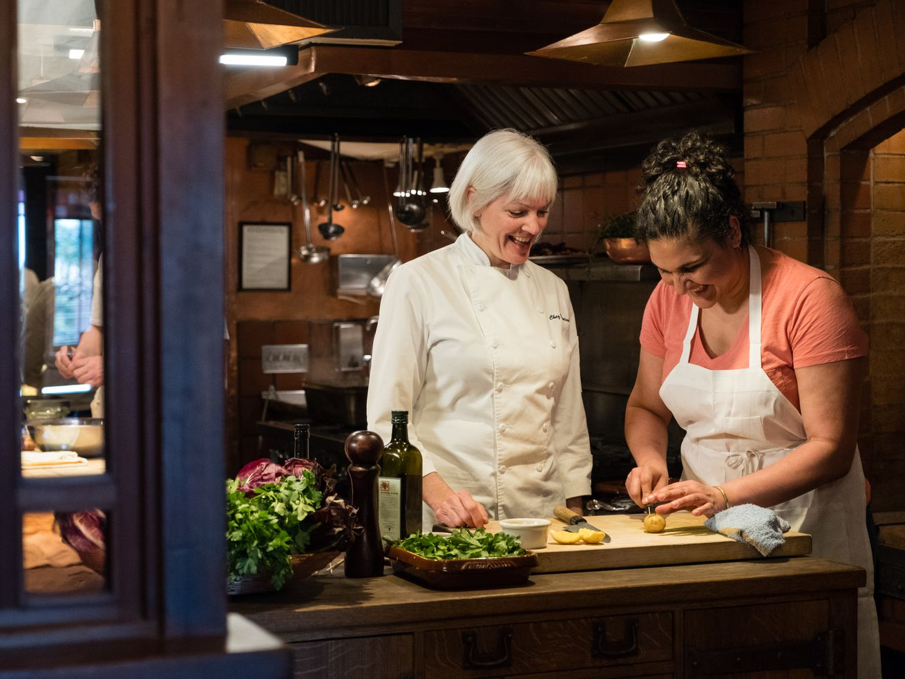 Amy Dencler and Samin Nosrat in the kitchen of Chez Panisse