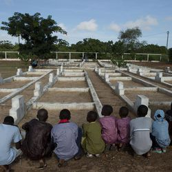Young relatives of people killed in the 2002 Joola ferry disaster pray as they visit a cemetery containing 140 unmarked graves of victims, in Mbao, outside Dakar, Senegal, Wednesday, Sept. 26, 2012, the tenth anniversary of the ferry's sinking. With an official death toll of 1,863 and only 64 survivors, the Joola disaster remains one of the deadliest in maritime history, surpassing by a large margin the death toll of roughly 1500 in the 1912 sinking of the Titanic.