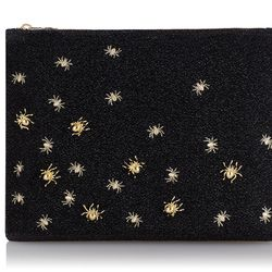"""Charlotte Olympia spider pouch, <a href=""""http://us.charlotteolympia.com/new-in/SPIDERPOUCH-SPHALLOWEEN.html?dwvar_SPIDERPOUCH-SPHALLOWEEN_color=GLITTER%20FABRIC_002_BLACK%2FGOLD"""">$495</a>"""