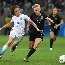 United States' Kelley O'Hara, left, and New Zealand's Hannah Wilkinson vie for the ball during a women's Olympic football tournament match at the Mineirao stadium in Belo Horizonte, Brazil, Wednesday, Aug. 3, 2016. (AP Photo/Eugenio Savio)