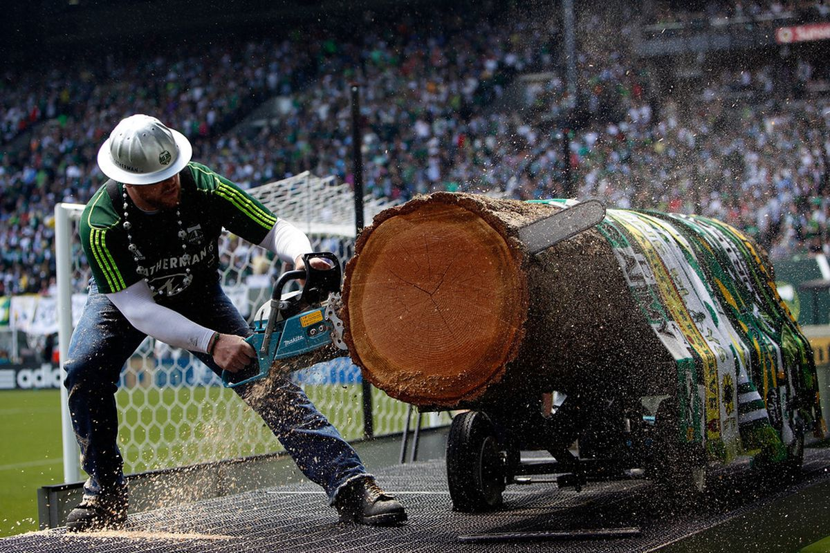 """PORTLAND, OR Joey Webber--otherwise known as """"Timber Joey"""" slices """"slabs"""" for each goal scored by the home side. The Goats will aim to keep his saw silent tonight. (Photo by Jonathan Ferrey/Getty Images)"""