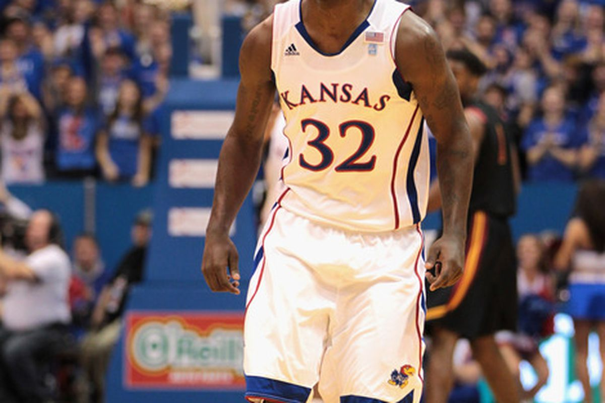 LAWRENCE KS - DECEMBER 18:  Josh Selby #32 of the Kansas Jayhawks reacts after scoring during the game against the USC Trojans on December 18 2010 at Allen Fieldhouse in Lawrence Kansas.  (Photo by Jamie Squire/Getty Images)