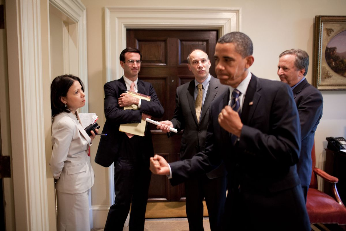 President Barack Obama feigns a punch while talking about health care reform with Nancy-Ann DeParle, Peter Orszag, Phil Schiliro and Larry Summers in the Outer Oval Office, July 13, 2009.