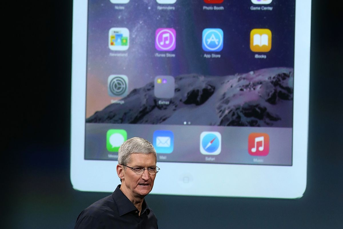 Apple CEO Tim Cook in front of an iPad