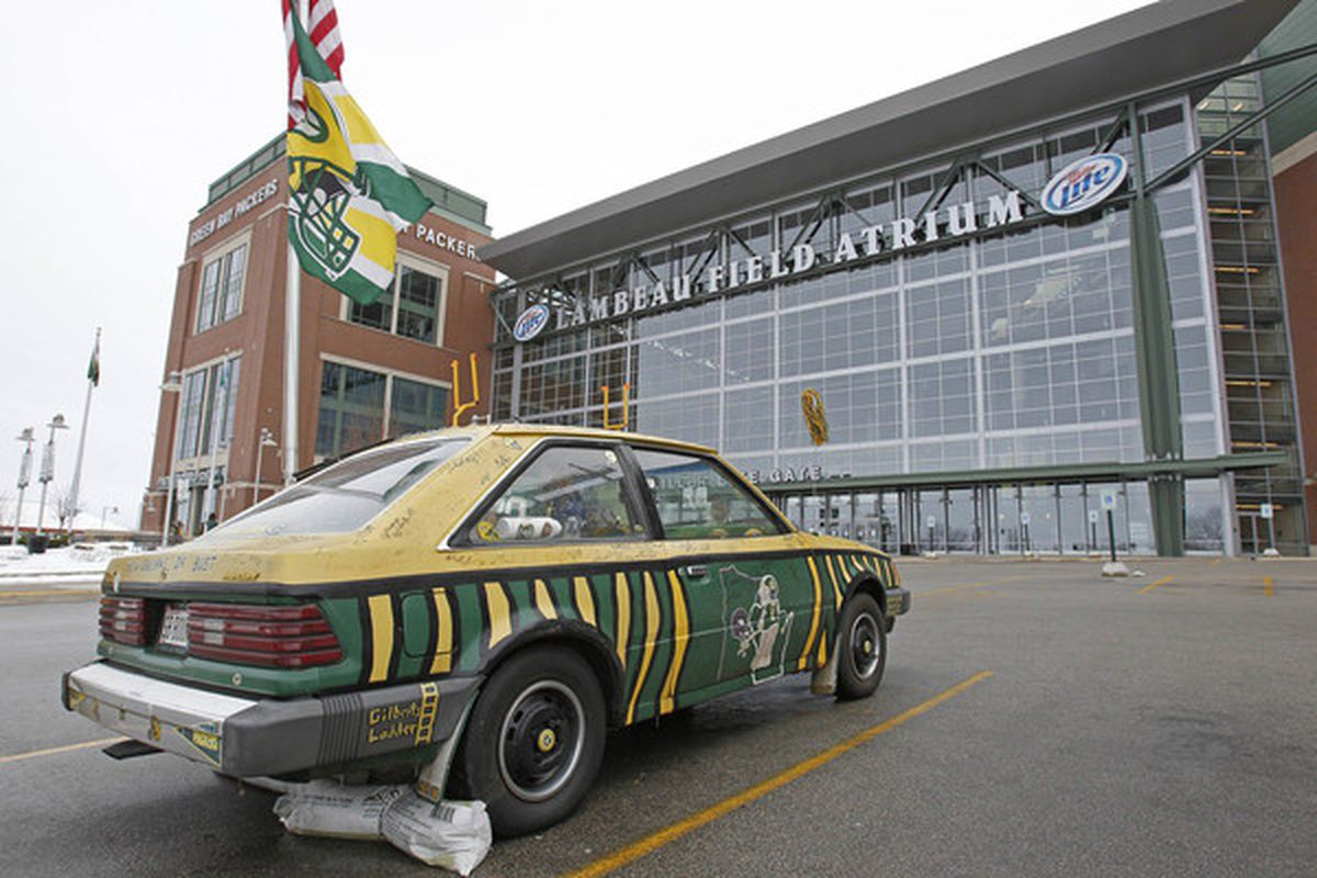 GREEN BAY WI - FEBRUARY 06: A car decorated in Green Bay Packers colors  sits parked in front of the Lambeau Field Atrium on February 6 2011 in Green Bay Wisconsin.  (Photo by Matt Ludtke/Getty Images)