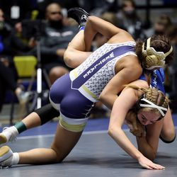 Celeste Detoles of Westlake takes down Bryton Moore of Pleasant Grove as they wrestle in class 120 as girls compete for the 6A State Wrestling championship at West Lake High in Saratoga Springs on Monday, Feb. 15, 2021.