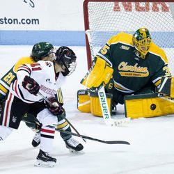 Clarkson University goaltender Shea Tiley makes a save.