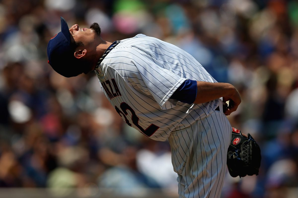 Starting pitcher Matt Garza of the Chicago Cubs stretches before throwing against the Arizona Diamondbacks at Wrigley Field in Chicago, Illinois.  (Photo by Jonathan Daniel/Getty Images)
