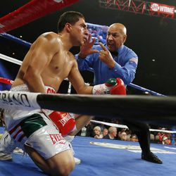 Referee Joe Cortez counts to Josesito Lopez during a super welterweight championship boxing match against Canelo Alvarez, of Mexico, on Saturday, Sept. 15, 2012, in Las Vegas. Alvarez won the match.
