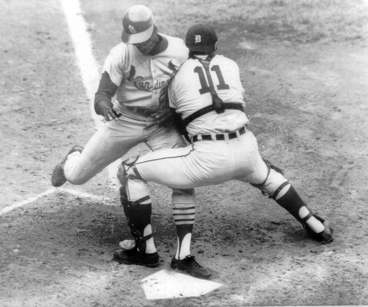 Detroit Tigers catcher Bill Freehan puts the tag on Lou Brock of the St. Louis Cardinals at the plate in the fifth inning of Game 5 of the 1968 World Series at Tiger Stadium.
