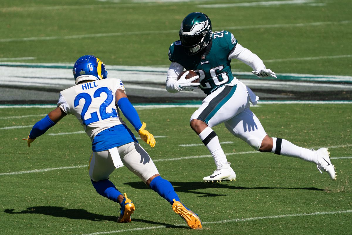Philadelphia Eagles running back Miles Sanders (26) runs with the ball against Los Angeles Rams cornerback Troy Hill (22) during the first quarter at Lincoln Financial Field.