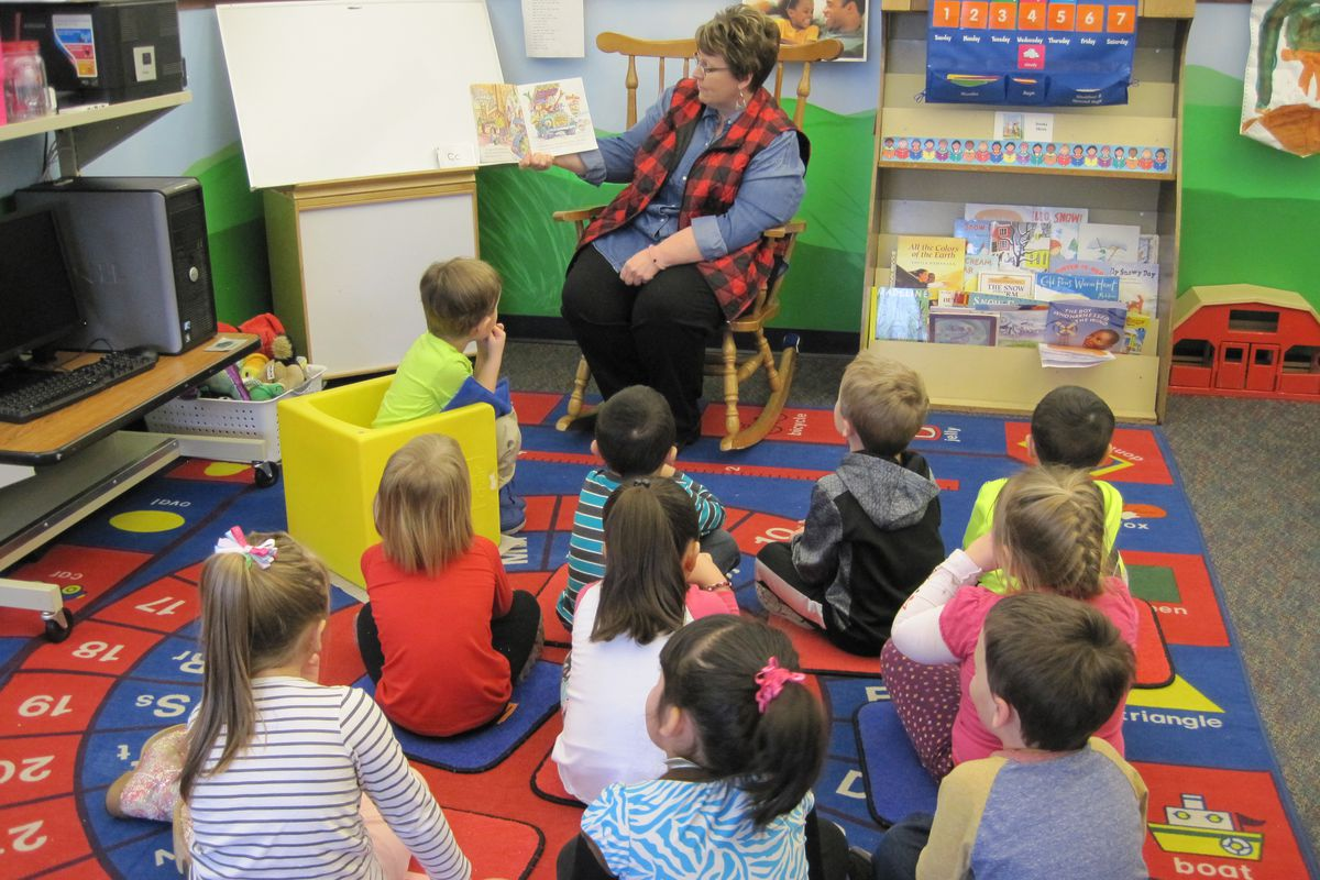 Marcia Walter, a teacher and the director at Dragon's Wagon Preschool, reads to her students.