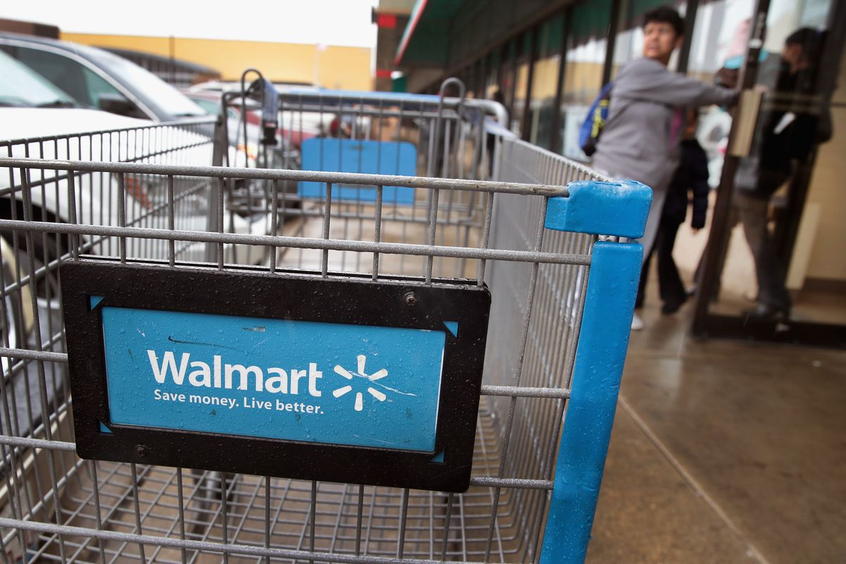 A blue shopping cart with a Walmart logo on the back.