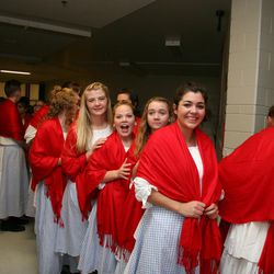 """A few of the some 1,200 youths of the Star Valley Wyoming Temple Cultural Celebration prepare to enter the gymnasium at the local high school during one of four performances of """"Mountain Heir: Clean and Pure."""" The next day, the new temple was dedicated by Elder David A. Bednar of the Quorum of the Twelve Apostles."""