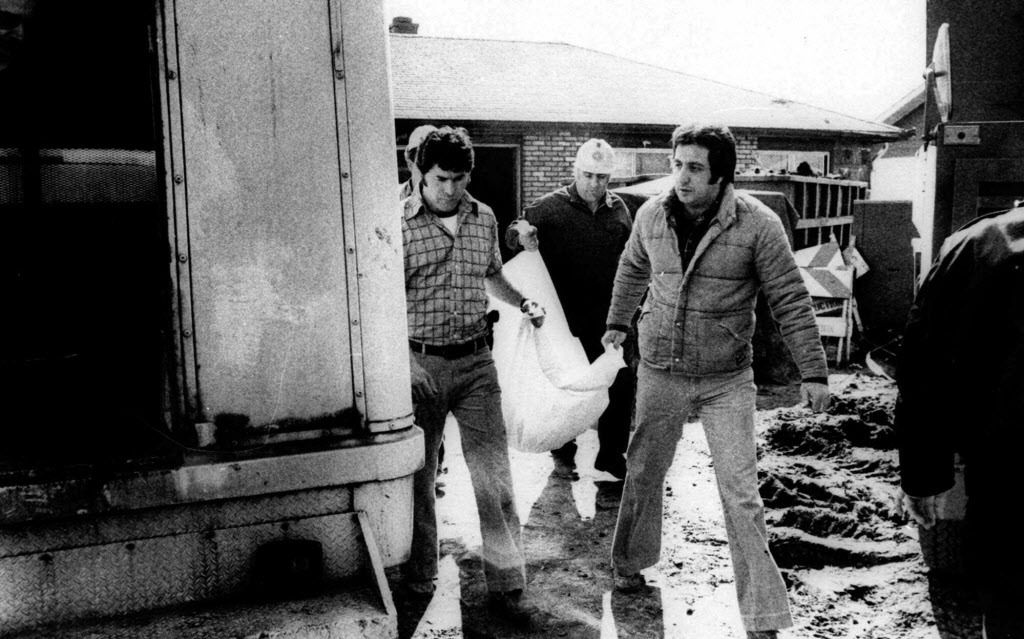 Cook County sheriff's police remove the remains of a body found under an addition to the home of serial killer John Wayne Gacy.   AP