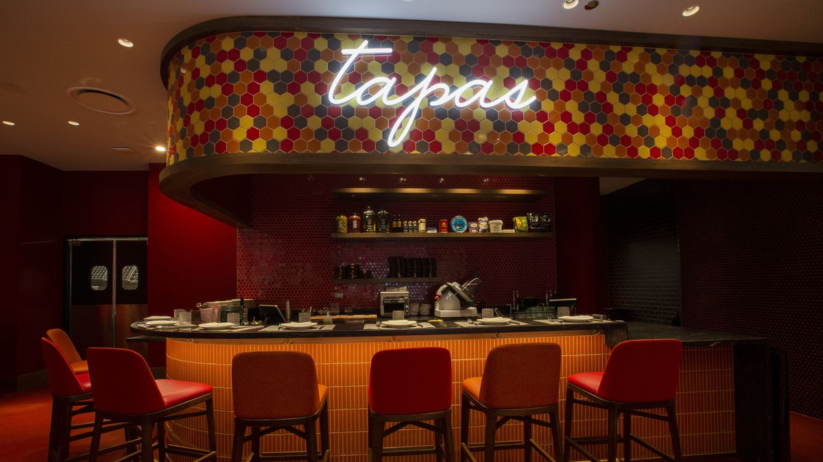 A tapas bar with neon signs.