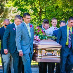 Pallbearers carry the casket of Kennedy Hansen in Ogden, Thursday, June 5, 2014.