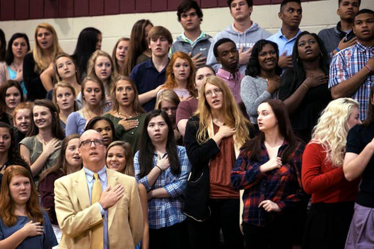 Students at St. George's Independent School in Collierville say the Pledge of Allegiance before the start of a chapel service in the school's gym in 2016. The Memphis-area school is among at least 57 private schools interested in participating in Tennessee's new education savings account program.