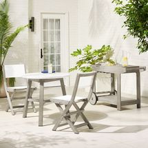 Grey set of 2 chairs, a table, and a bar cart