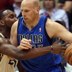 Al Jefferson of the Utah Jazz defends against Chris Kaman of the Dallas Mavericks during NBA basketball in Salt Lake City, Monday, Jan. 7, 2013.