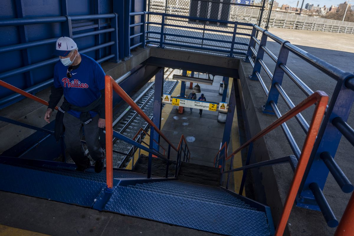 Baseball fans exit LIRR's Mets-Willets Point Station ahead of double-header versus Philadelphia on April 13, 2021.