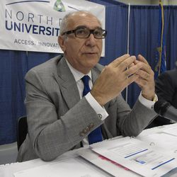 Ham Shirvani, left, the chancellor of North Dakota's university system, gestures as he describes a proposal for stricter entrance standards for North Dakota's public colleges at a meeting of the state Board of Higher Education on Wednesday, Sept. 26, 2012, at the Bismarck Public Schools Career Academy in Bismarck, N.D. The new standards, which the board approved Wednesday, will take full effect in 2015. At right is Duaine Espegard, chairman of the Board of Higher Education.