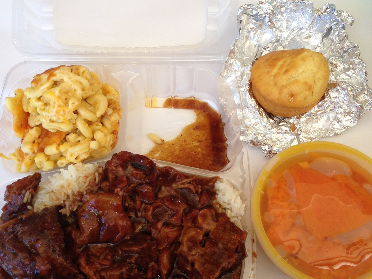 Neckbone plate with mac and cheese, yams, and cornbread on the side