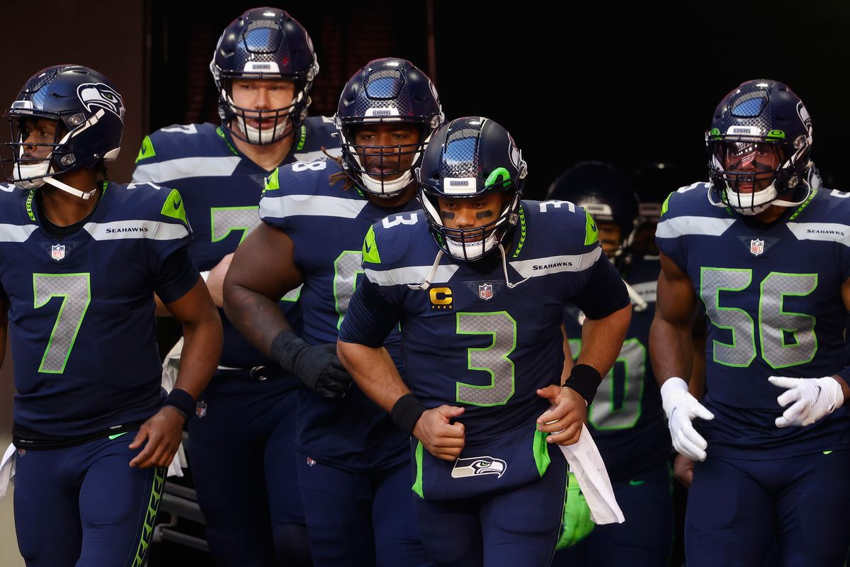 Quarterback Russell Wilson #3 of the Seattle Seahawks leads teammates onto the field before the NFL game against the San Francisco 49ers t State Farm Stadium on January 03, 2021 in Glendale, Arizona. The Seahawks defeated the 49ers 26-23.