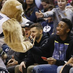 Utah Jazz player Donovan Mitchell greets Cosmo during the BYU game in Provo on Thursday, Dec. 28, 2017. BYU won 69-45.