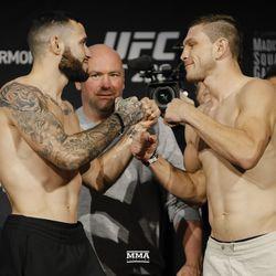 Shane Burgos and Kurt Holobaugh square off at UFC 230 weigh-ins.