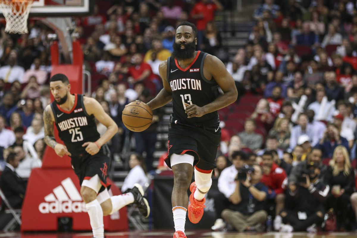 Houston Rockets guard James Harden dribbles the ball against the Miami Heat during the second quarter at Toyota Center.