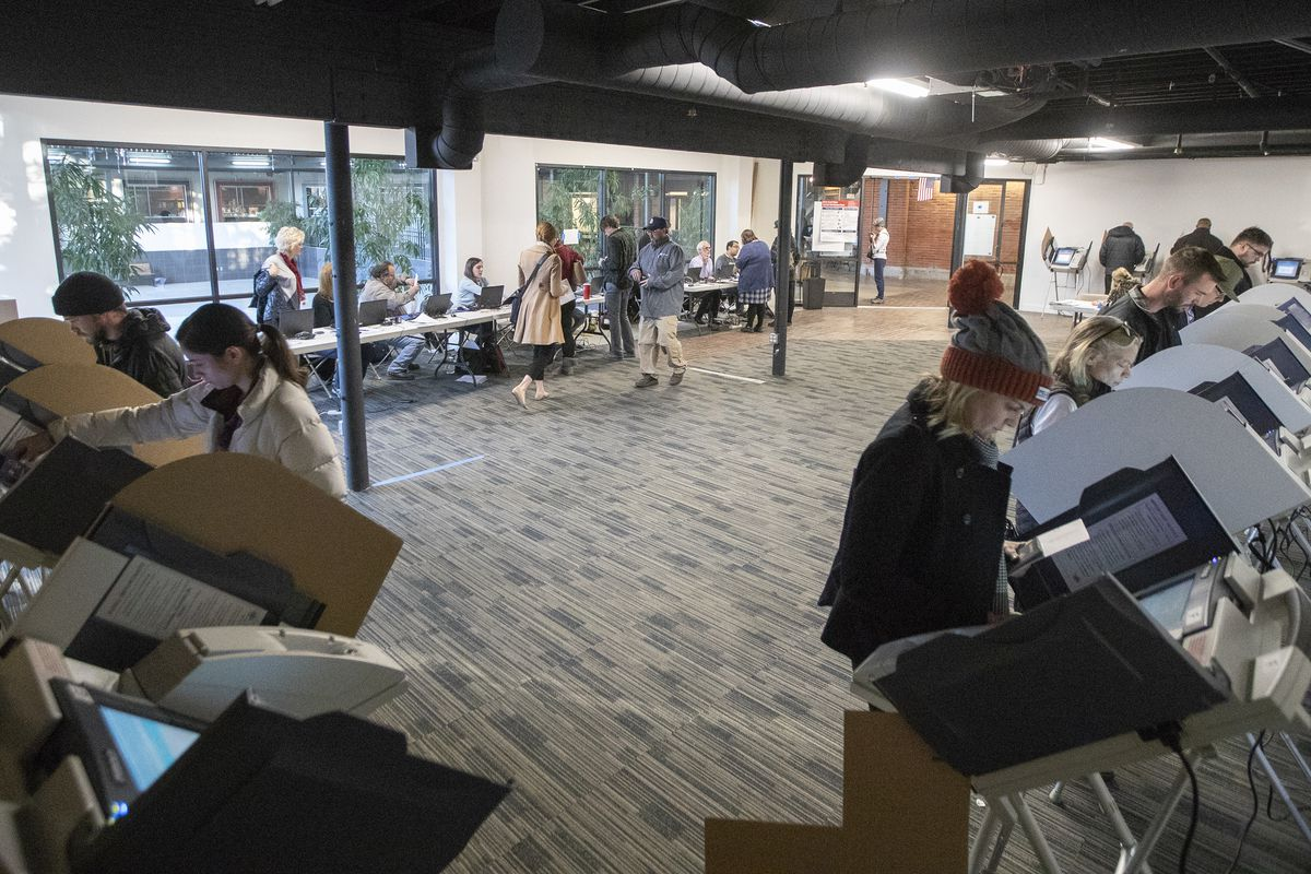 Voters cast their ballots at a Polling station at Trolley Square in Salt Lake city on Tuesday, Nov. 6, 2018.