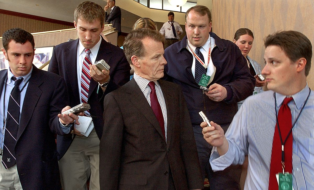 Illinois House Speaker Michael Madigan, D-Chicago, center, is surrounded by the media in Springfield in 2005.