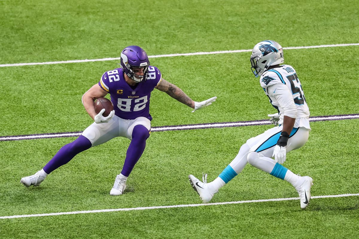 Minnesota Vikings tight end Kyle Rudolph (82) carries the ball during the third quarter against the Carolina Panthers at U.S. Bank Stadium.