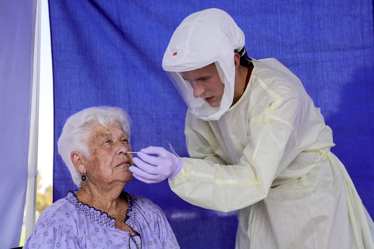Gloria Ford gets tested for COVID-19 by phlebotomist Ethan Laudie at an Intermountain Healthcare COVID-19 mobile testing site outside of Orem Community Hospital in Orem on Tuesday, Oct. 6, 2020.
