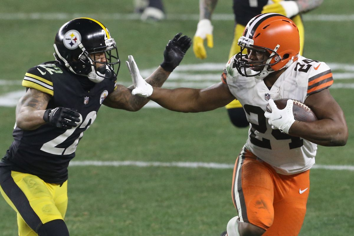 Cleveland Browns running back Nick Chubb (24) carries the ball against Pittsburgh Steelers cornerback Steven Nelson (22) during the second quarter at Heinz Field. The Browns won 48-37.