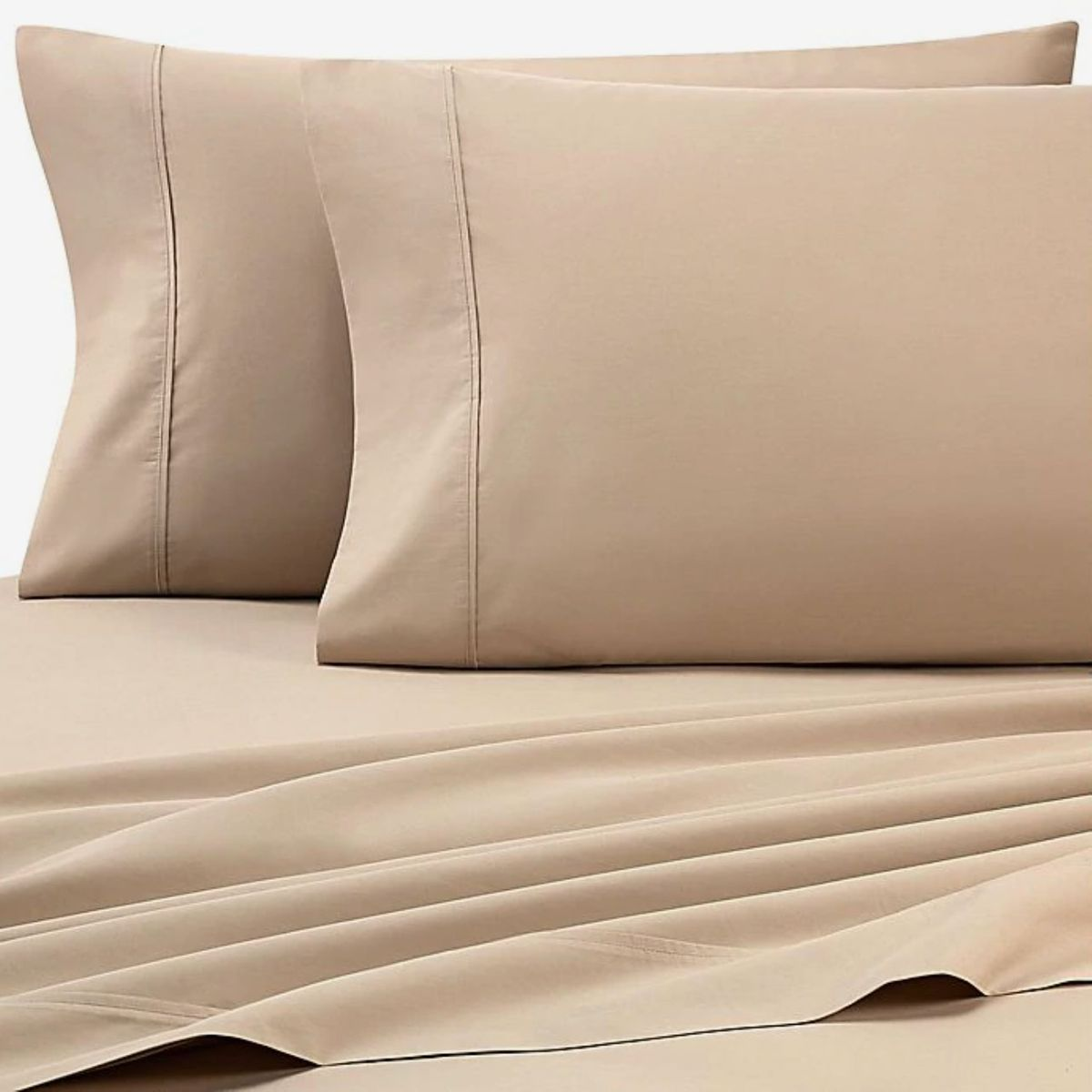Two brown pillows and matching sheets.