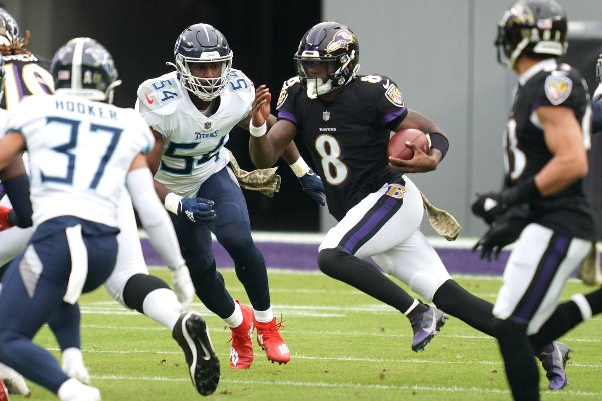 Baltimore Ravens quarterback Lamar Jackson (8) pressured in the first quarter by Tennessee Titans linebacker Rashaan Evans (54) at M&T Bank Stadium.