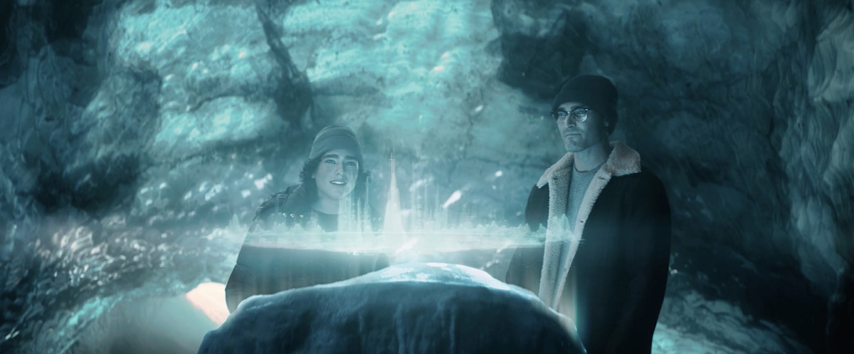 Clark Kent and his son Jordan stand in the frozen Fortress of Solitude, looking at a hologram of a Kryptonian city in Superman & Lois
