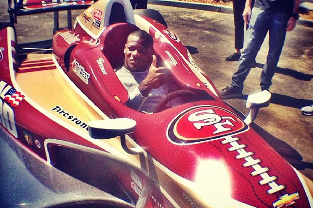 """Kendall Hunter hops in the Panther Racing IndyCar (courtesy of <a href=""""http://www.twitter.com/49ers"""" target=""""new"""">@49ers</a> on <a href=""""http://instagram.com/p/Orqg5aCetv/"""" target=""""new"""">Instagram</a>)"""