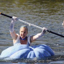 Cheryl Shelley, dressed as Cinderella, wins her heat as part of the 2013 Mountain Valley Seed Co. Ginormous Pumpkin Regatta at Sugarhouse Park on Saturday, October 19, 2013.