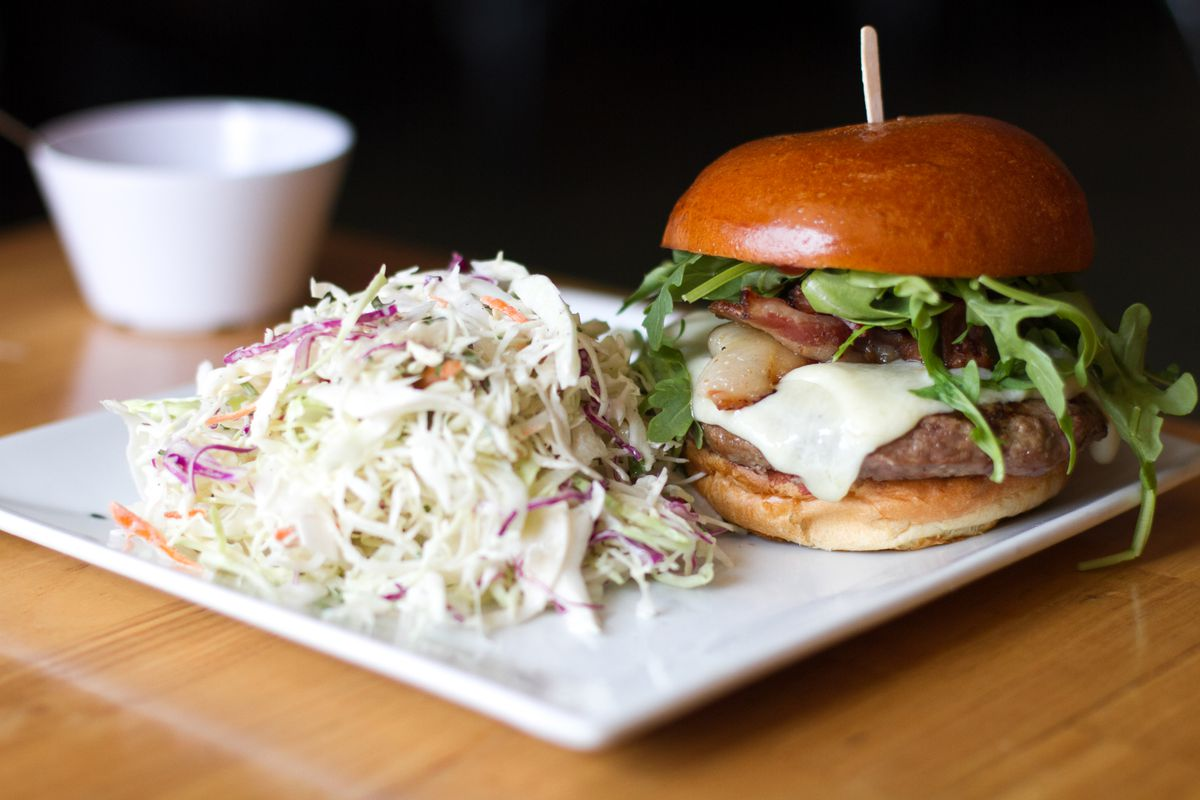The Golden State, a burger restaurant, shown on a white square plate.