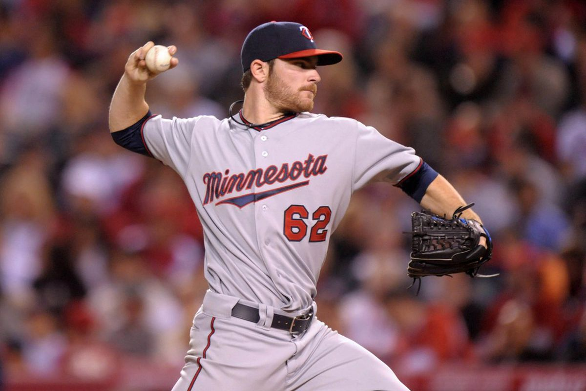 May 2, 2012; Anaheim, CA, USA; Minnesota Twins starter Liam Hendriks (62) pitches against the Los Angeles Angels at Angel Stadium. Mandatory Credit: Kirby Lee/Image of Sport-US PRESSWIRE