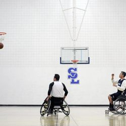 Jeff Griffin watches his shot before practice with his teammates at Salt Lake Community College's Lifetime Activities Center on Feb. 20.