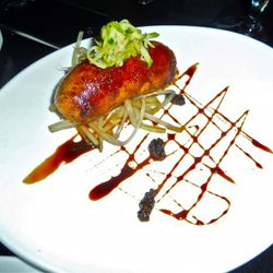 """One of the best things that night: housemade sausage appetizer with """"Napple"""" kraut and bourbon caramel sauce.  Meat was sort of loose inside the casing and it tasted like a regular old Italian pork sausage. $14."""