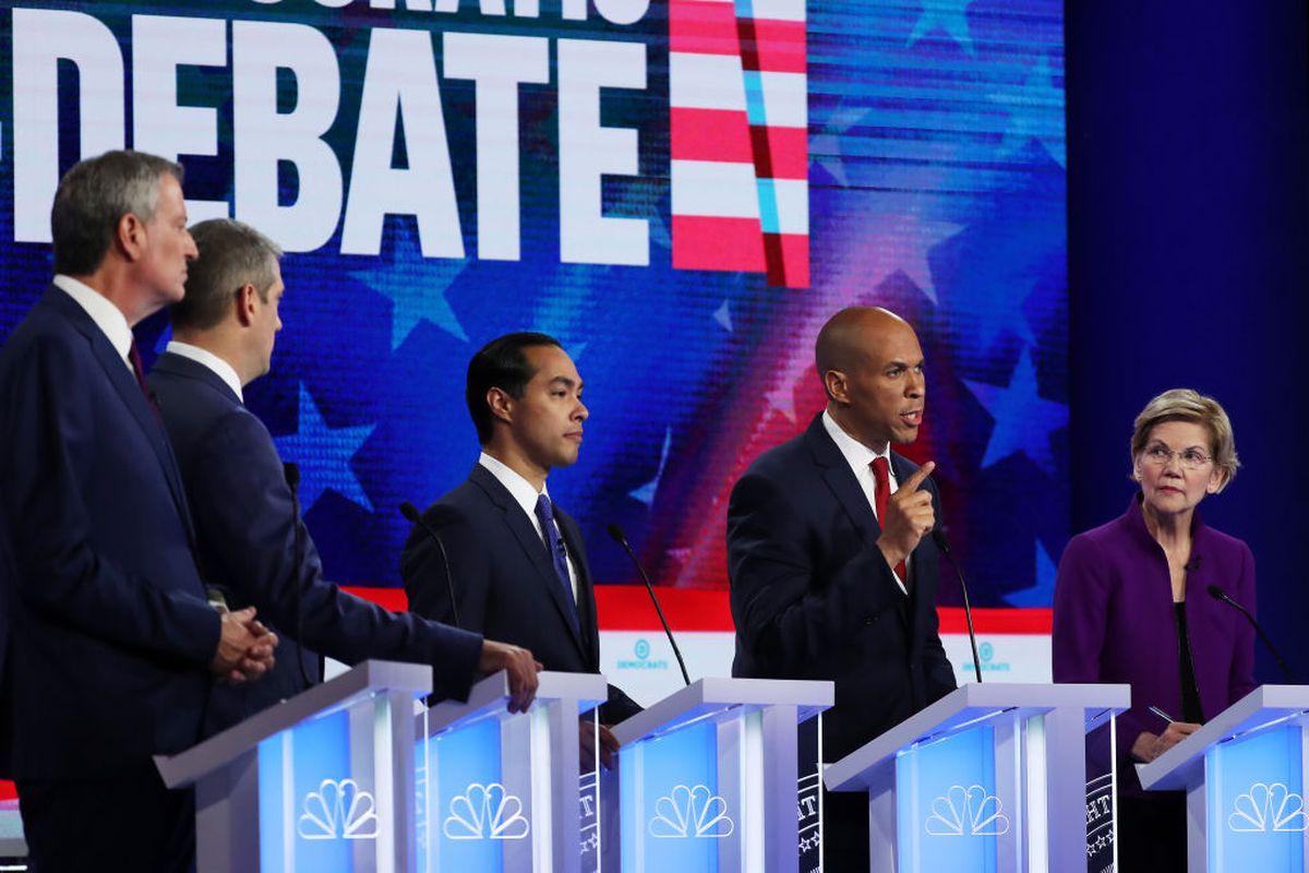 MIAMI, FLORIDA - JUNE 26: (L-R) New York City Mayor Bill De Blasio, Rep. Tim Ryan (D-OH), former housing secretary Julian Castro, Sen. Cory Booker (D-NJ) and Sen. Elizabeth Warren (D-MA) take part in the first night of the Democratic presidential debate on June 26, 2019 in Miami, Florida.