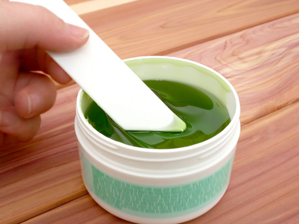 """Image Via <a href=""""http://www.shutterstock.com/pic-51751/stock-photo-jar-of-sticky-green-hair-remover-shallow-dof-with-focus-on-applicator-and-gel.html"""">Shutterstock</a>"""