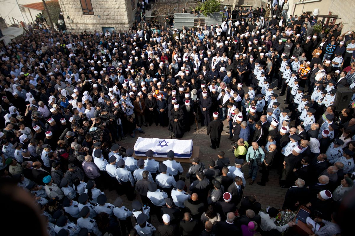 A funeral for the Druze Israeli police officer killed during the Synagogue attack.